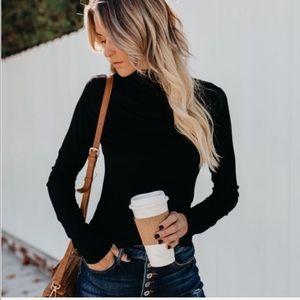 Black mock neck knit long sleeve bodyfit top